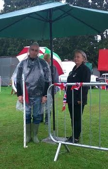 Colin not happy that its raining. Jan looking on. Havering show 2015