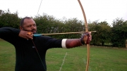 Mark Turner with his longbow. Split second before shooting.